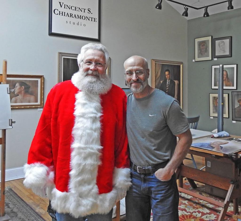 image of vince chiaramonte in his studio with santa claus