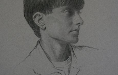 charcoal drawing of profile of a school aged boy