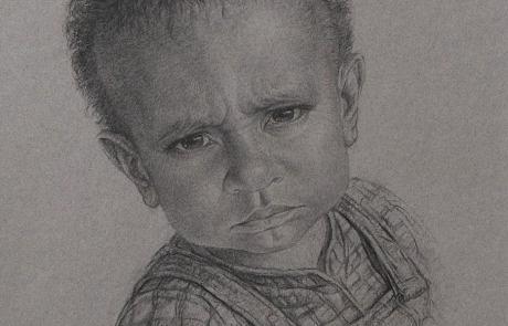 charcoal drawing of little grumpy boy